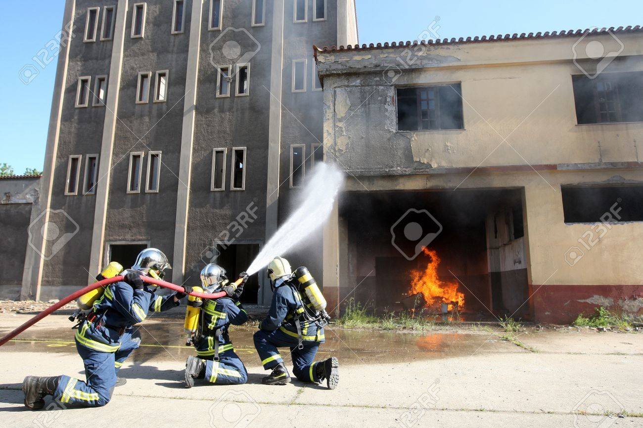 THESSALONIKI, GREECE - APRIL 19:Firefighter fighting For A Fire Attack, During A Training Exercise for the consequences earthquake in Industrial Area of Sindos on April 19,2013 in Thessaloniki, Greece Stock Photo - 19416266