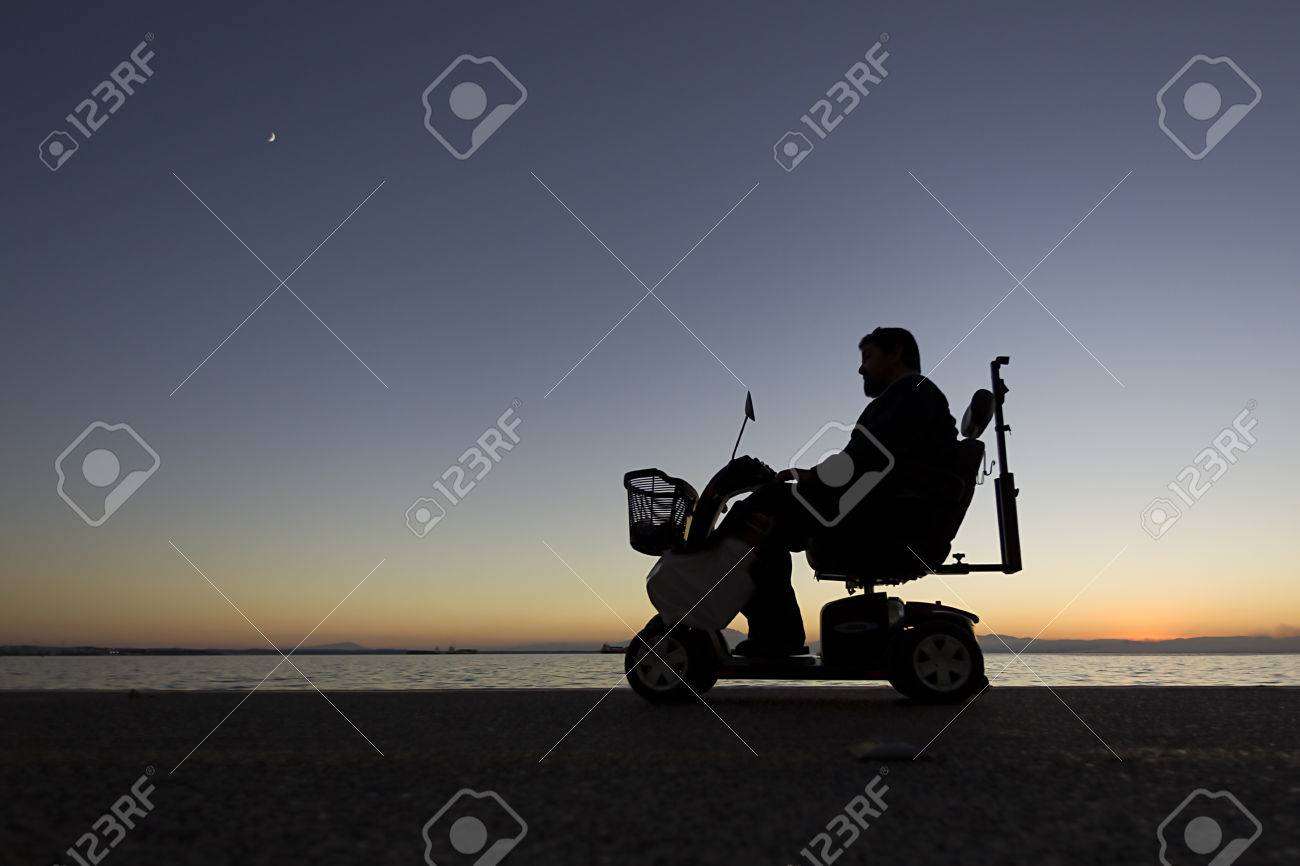silhouette of a person with disabilities on wheelchair on the sunset Stock Photo - 23850596