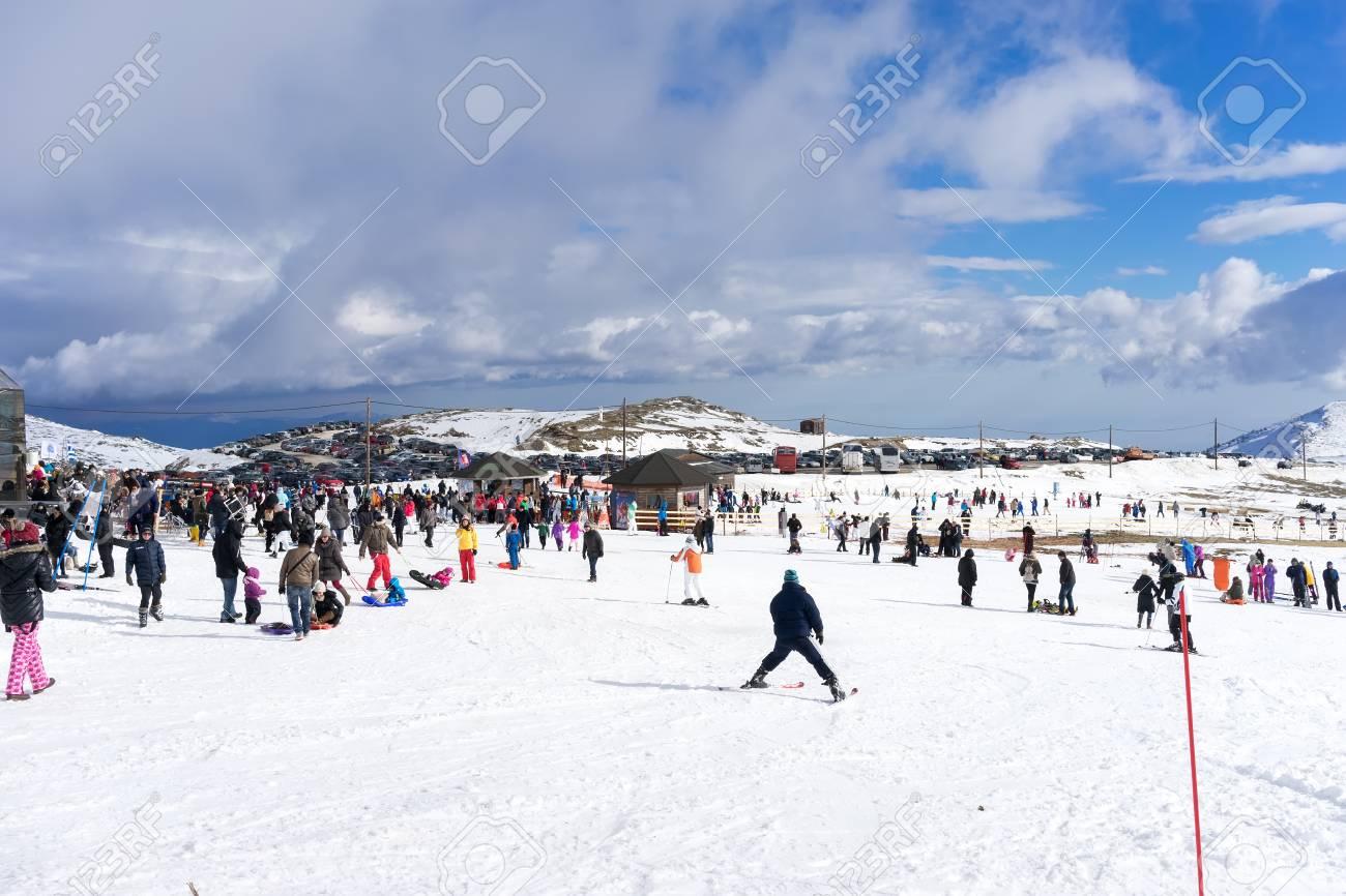 kaimaktsalan, greece - february 13, 2014: skiers enjoy the snow