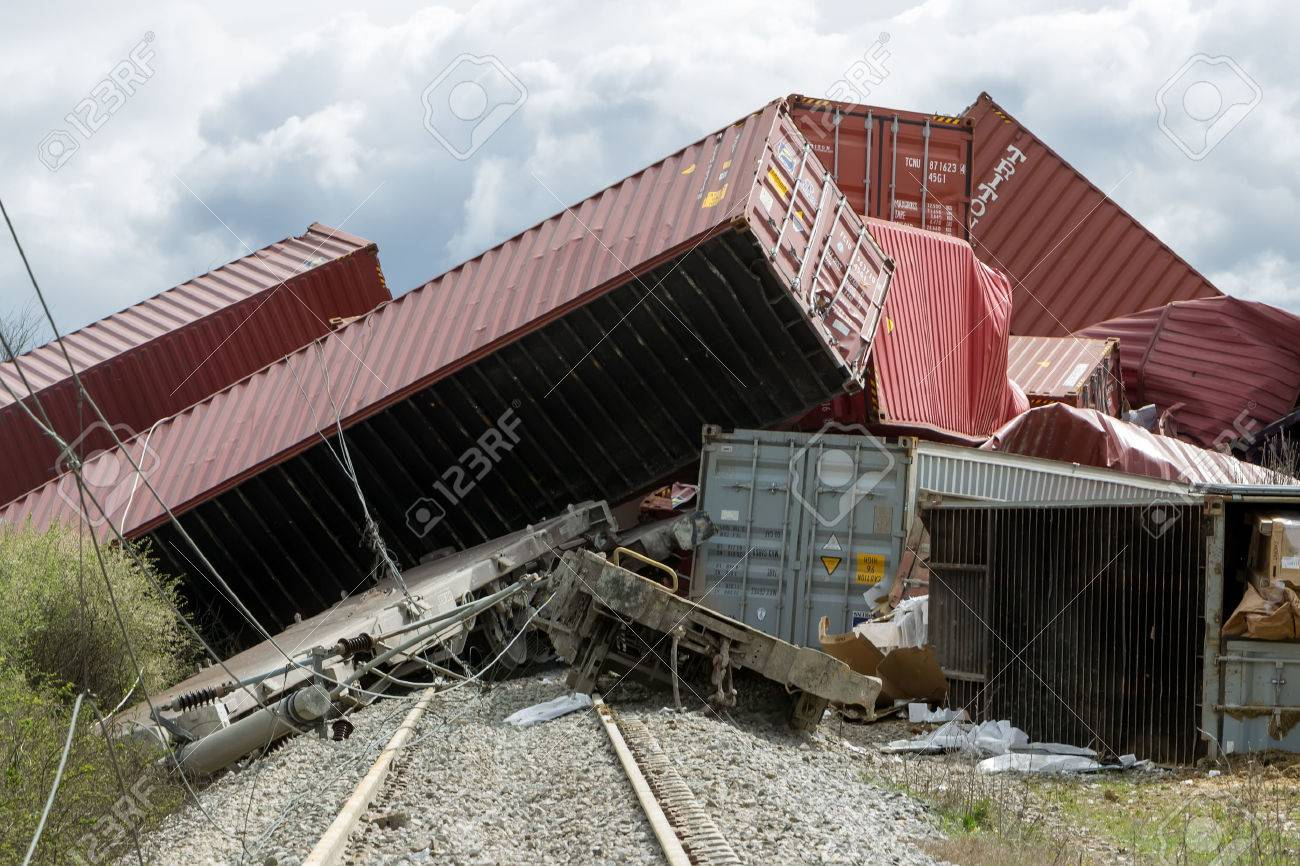 THESSALONIKI, GREECE, MARCH 28,2015: Derailed train coaches at the site of a train accident at the Gefyra community, in northern Greece. The train was carrying electronic equipment . Standard-Bild - 38256268