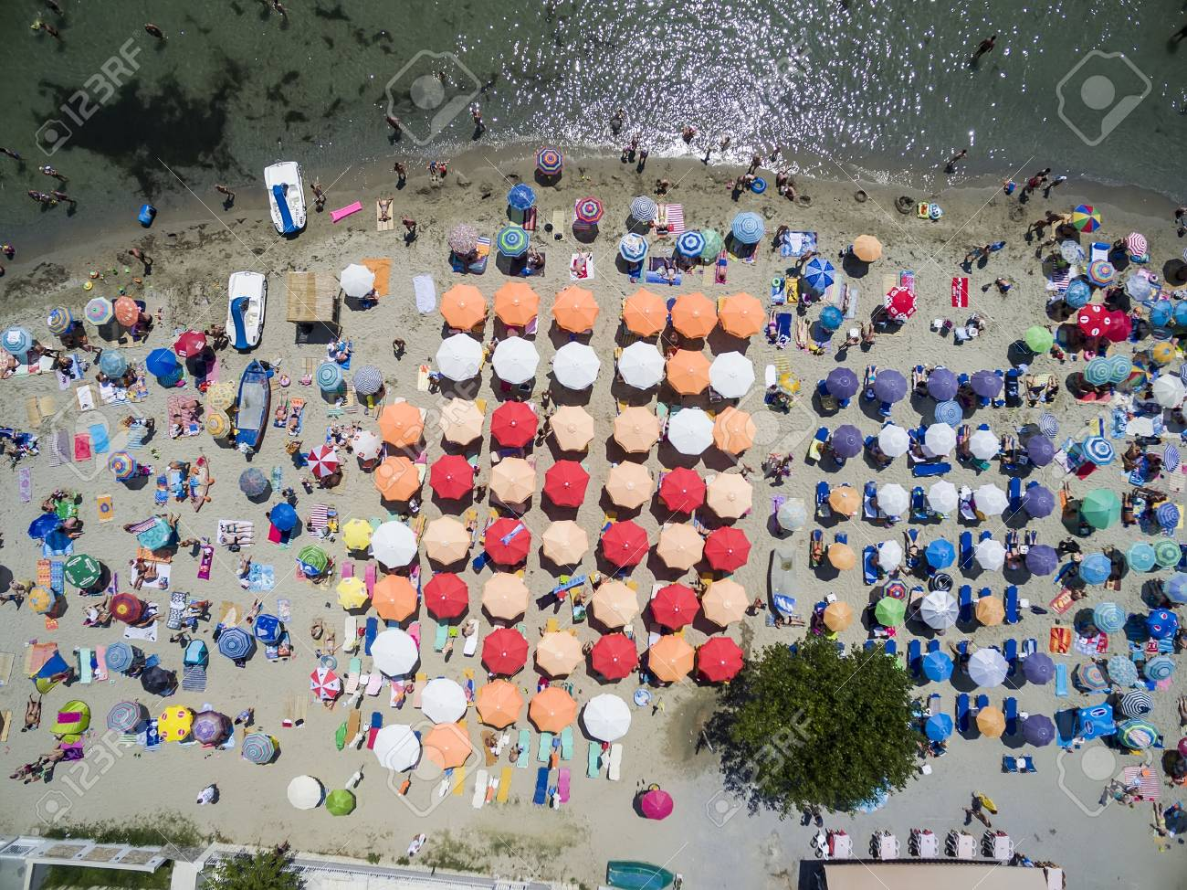 Aerial View Of The Beach Katerini In Greece Colorful Umbrellas And People Who Swims