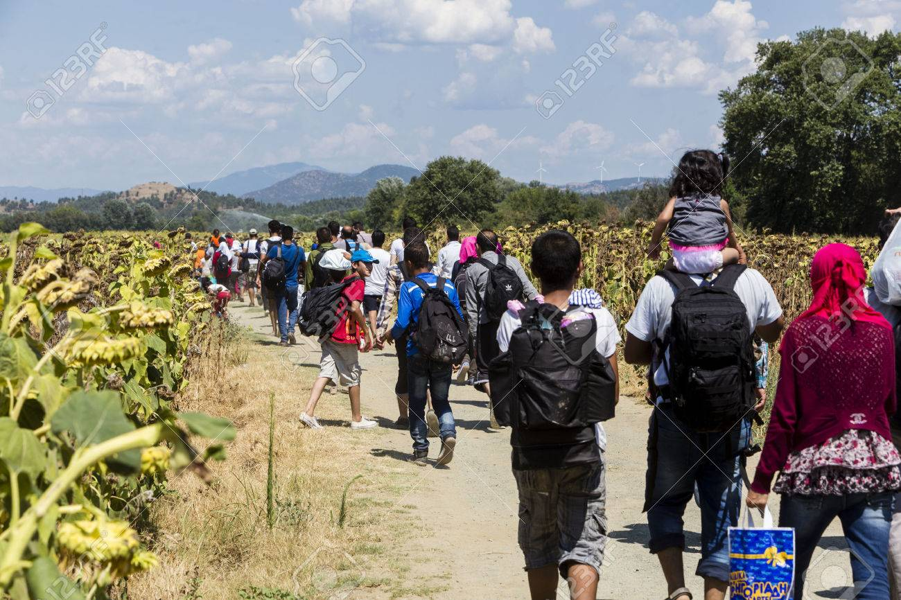 Idomeni, Greece - August 19 , 2015: Hundreds of immigrants are in a wait at the border between Greece and FYROM waiting for the right time to continue their journey from unguarded passages Standard-Bild - 44215110