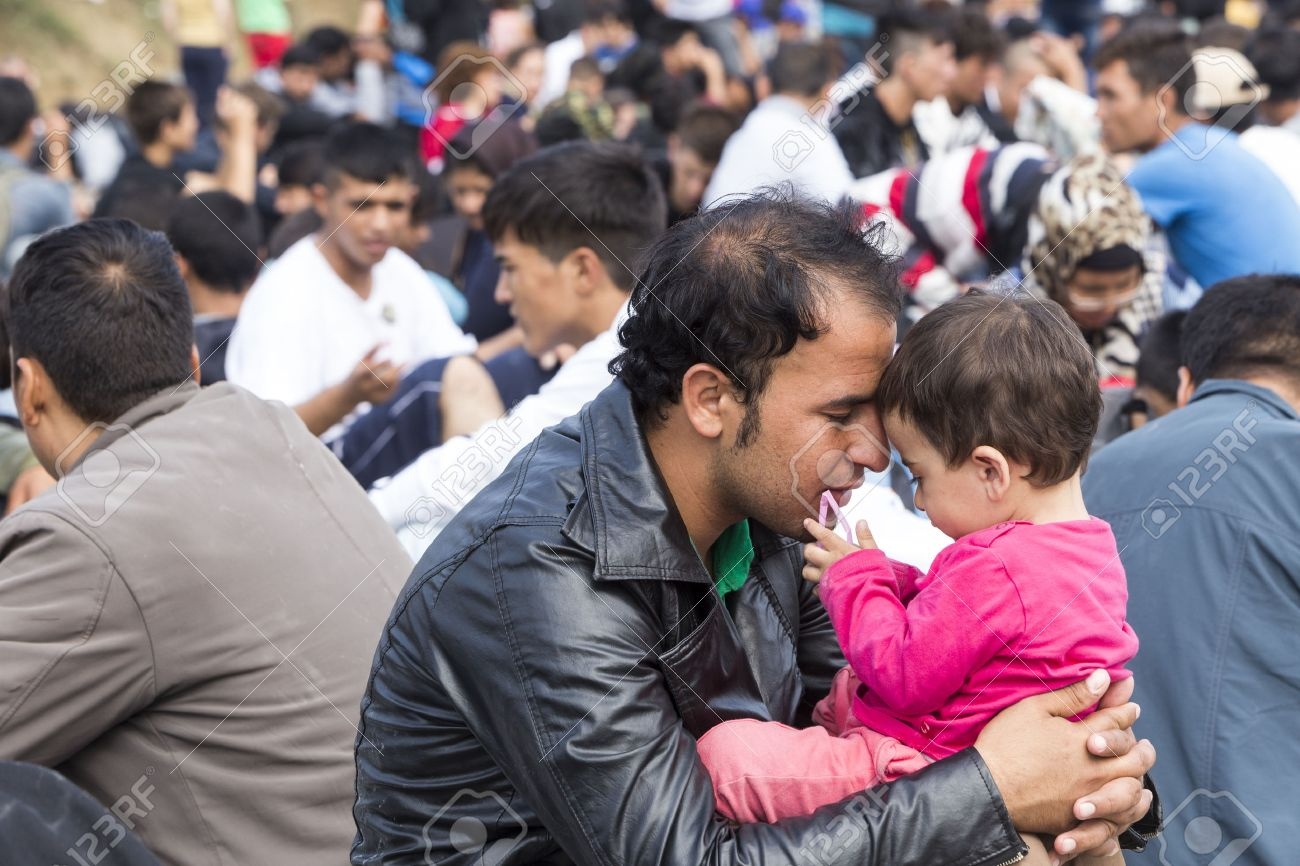 Idomeni, Greece - September 24 , 2015: Hundreds of immigrants are in a wait at the border between Greece and FYROM waiting for the right time to continue their journey from unguarded passages Standard-Bild - 45566309