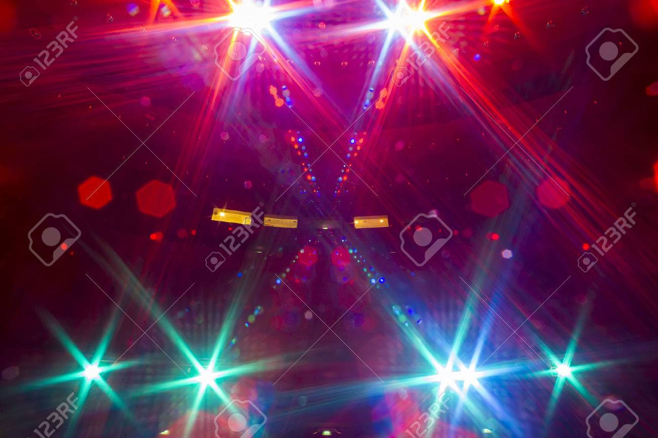 View from the illuminated empty concert stage to the dark auditorium Standard-Bild - 47030246