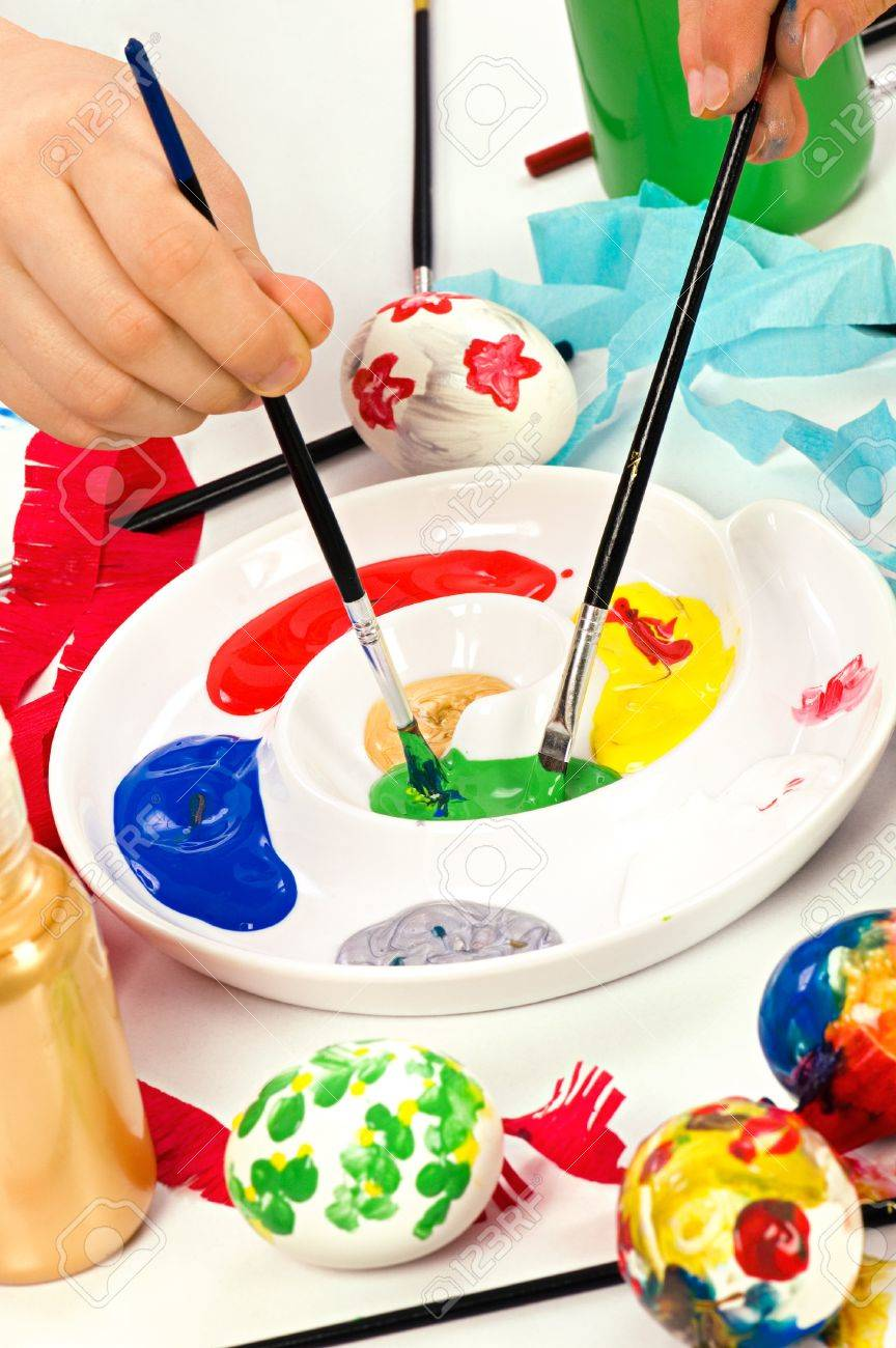 Colourful paints on palette with brushes ready for painting easter eggs. Concept for art and craft classes. Stock Photo - 10709176