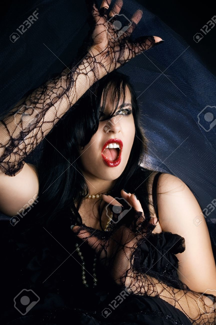 Attractive female vampire screaming. Woman dressed up for halloween party. Stock Photo - 10804767