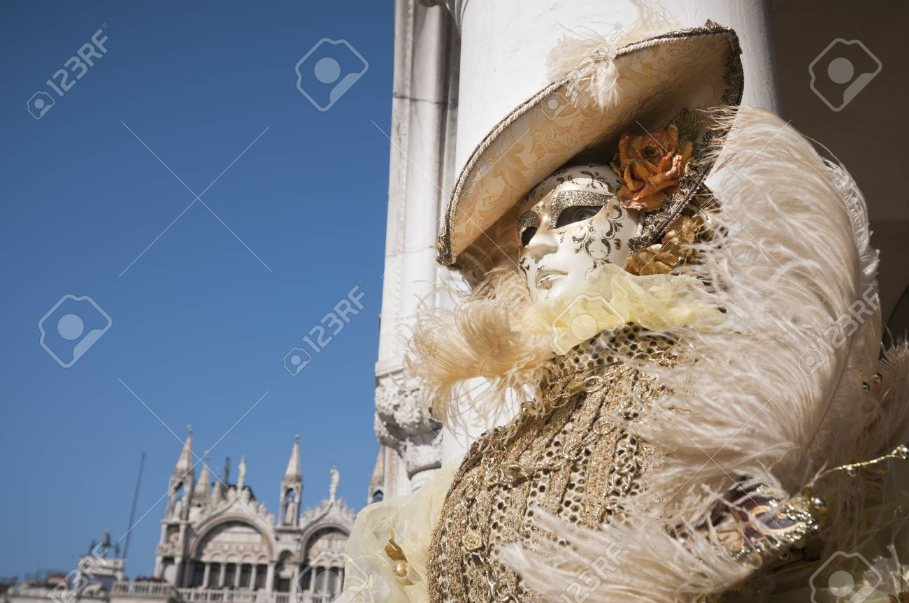 Venice, Italy - March 4, 2011: Mask posing in Saint Mark square during famous Venetian Carnival celebrations. Shot in Venice, Italy Stock Photo - 17712973