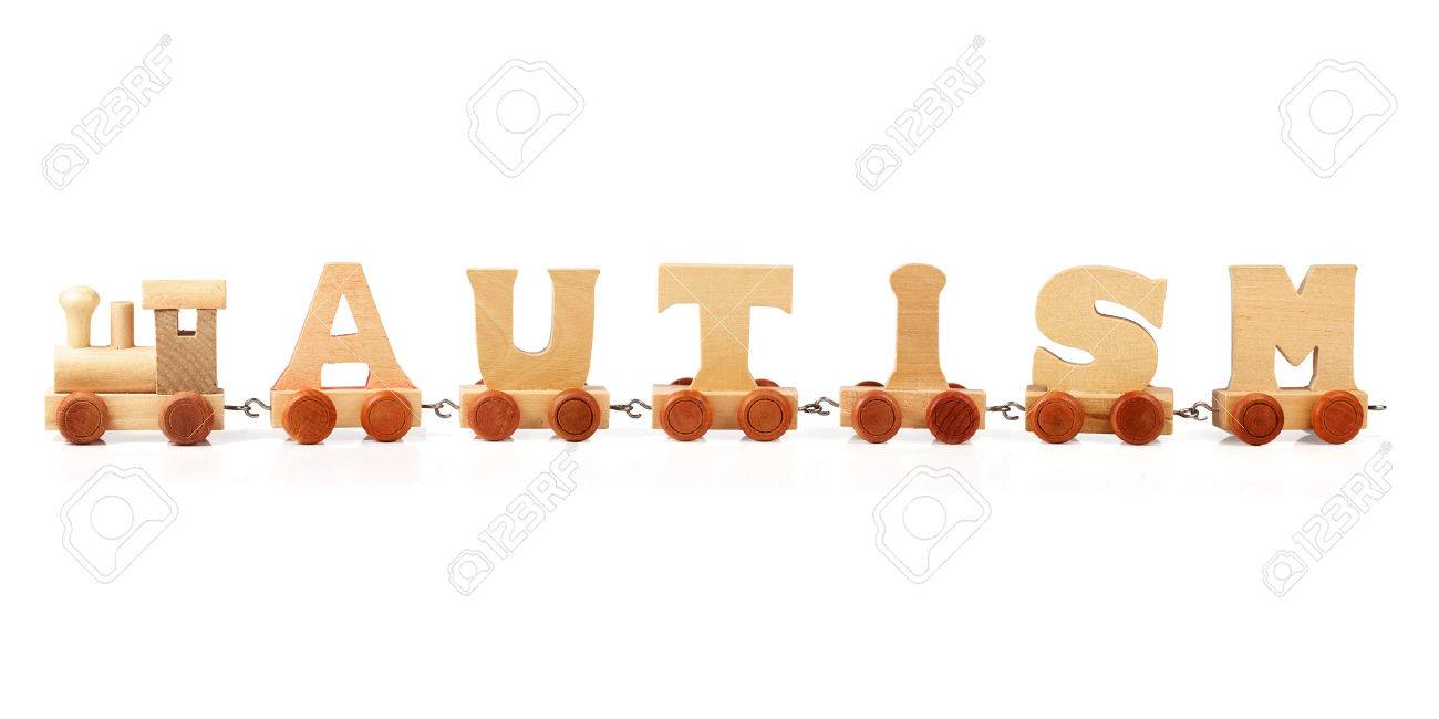 autism spelled out in wooden train letters on white background stock photo 30909123