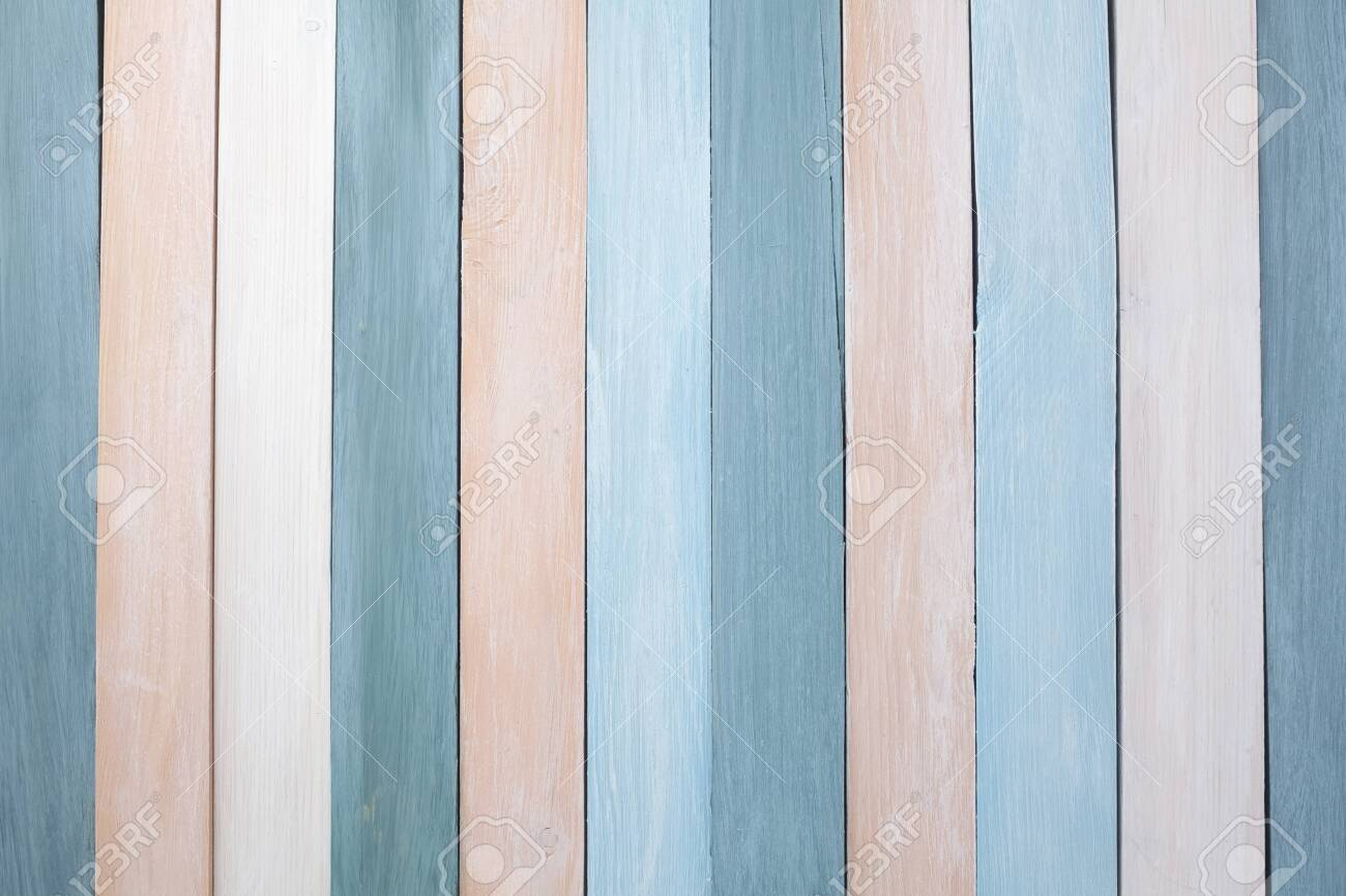Pastel colors wooden wall background. Flat lay - 122222969