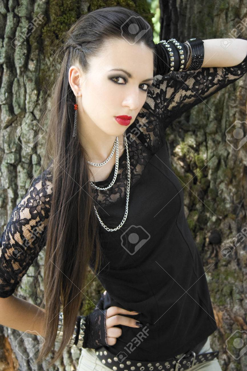 Beautiful Girl With Long Hair In Punk And Rock Inspired Outfit Stock
