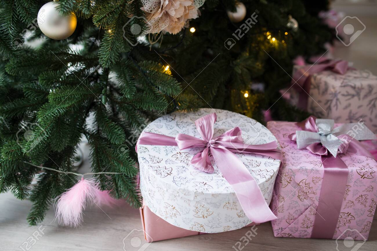 Boxes Of Pink Color With Gifts Under A Christmas Tree Daylight Stock Photo Picture And Royalty Free Image Image 130100502