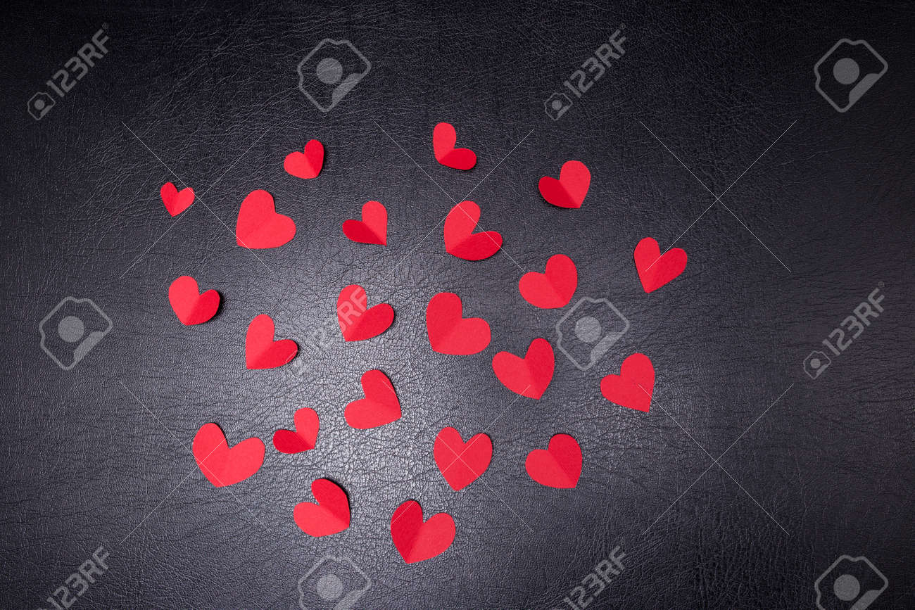 A lot of small hearts of red color against on a black background. Happy Valentines Day. - 159604501