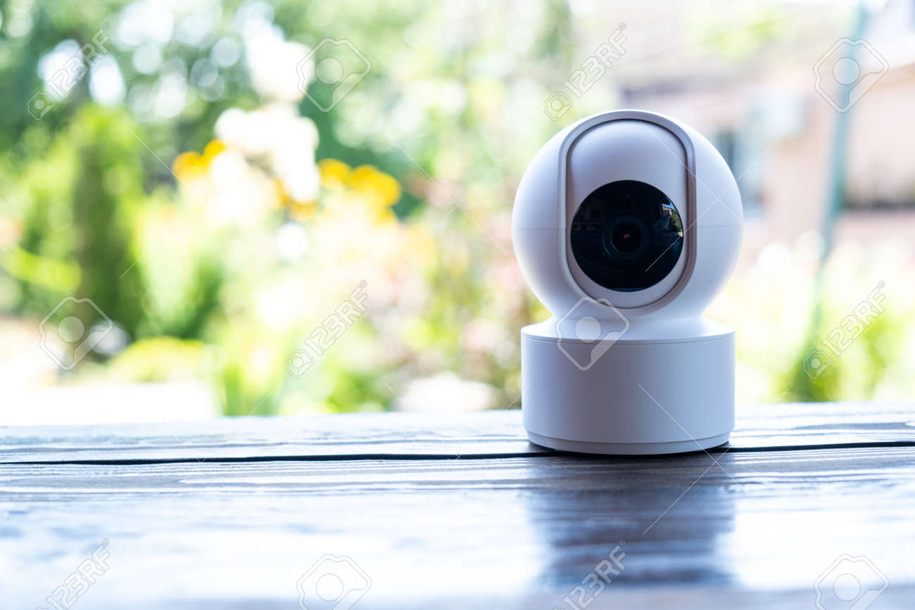 Video surveillance equipment on the table. Compact security camera for outdoor or private home security - 171471718