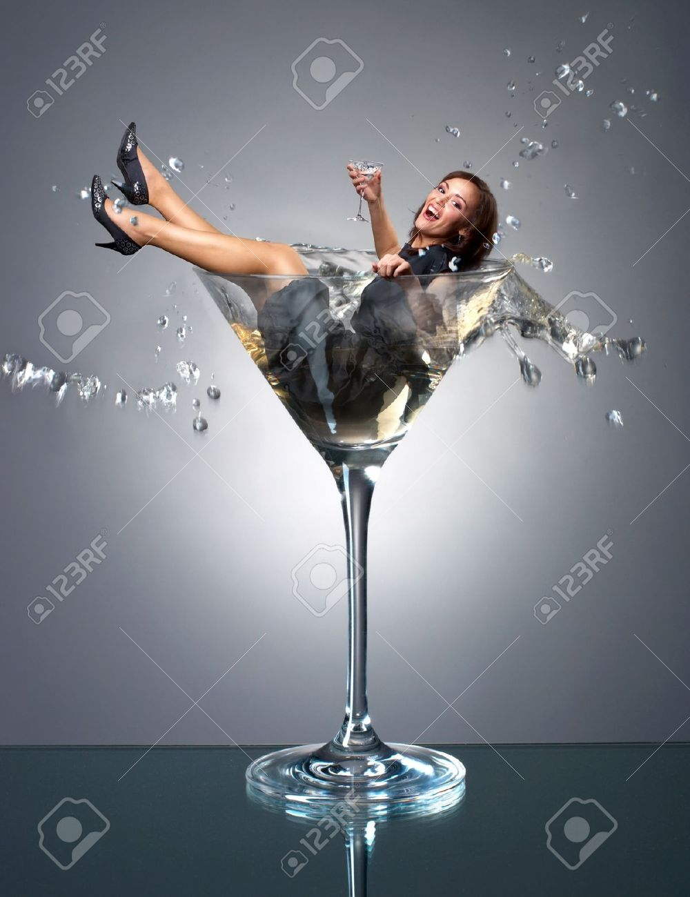 Smilng girl fall in martini glass Stock Photo - 12535100