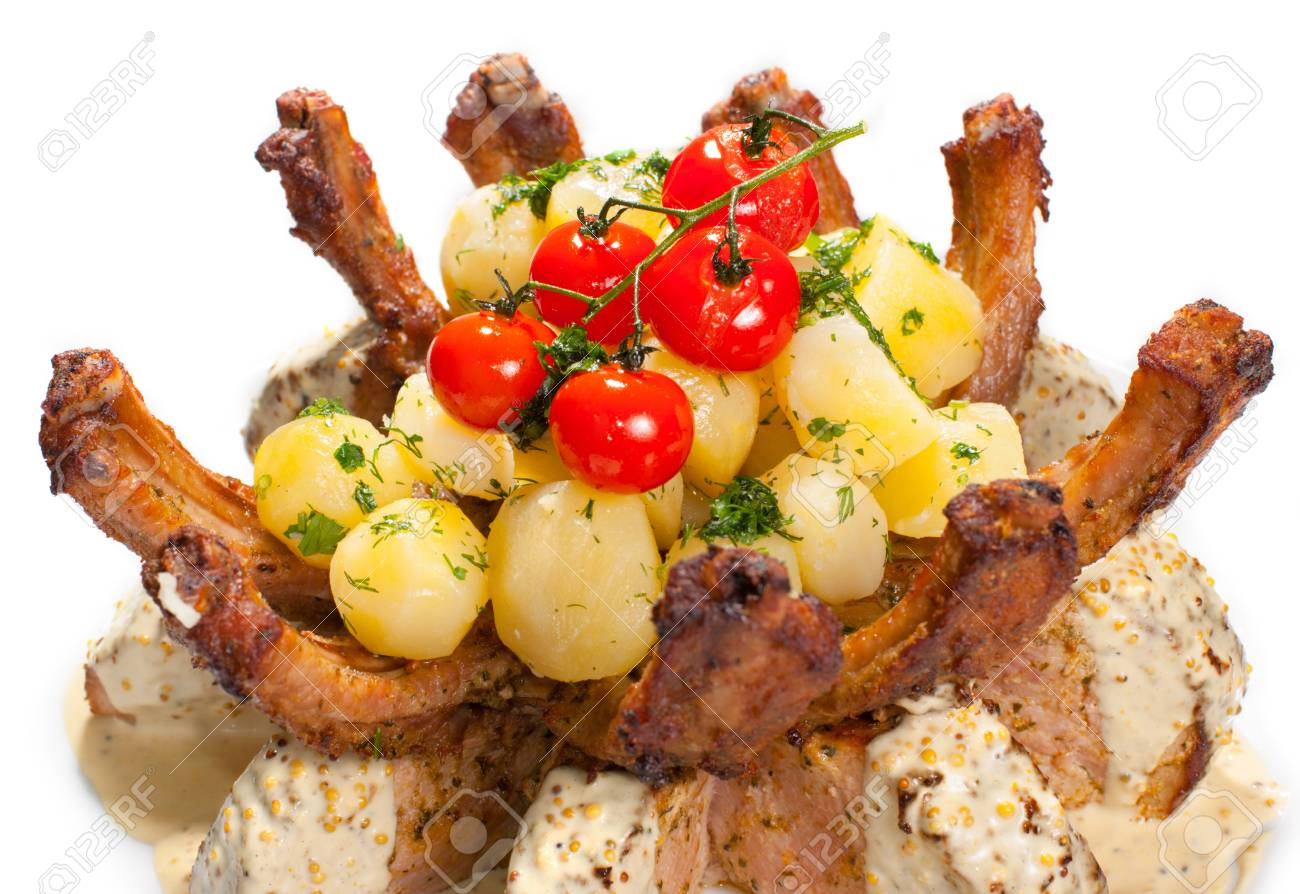 Delicious roasted pork with potatoes and tomato Stock Photo - 13860464