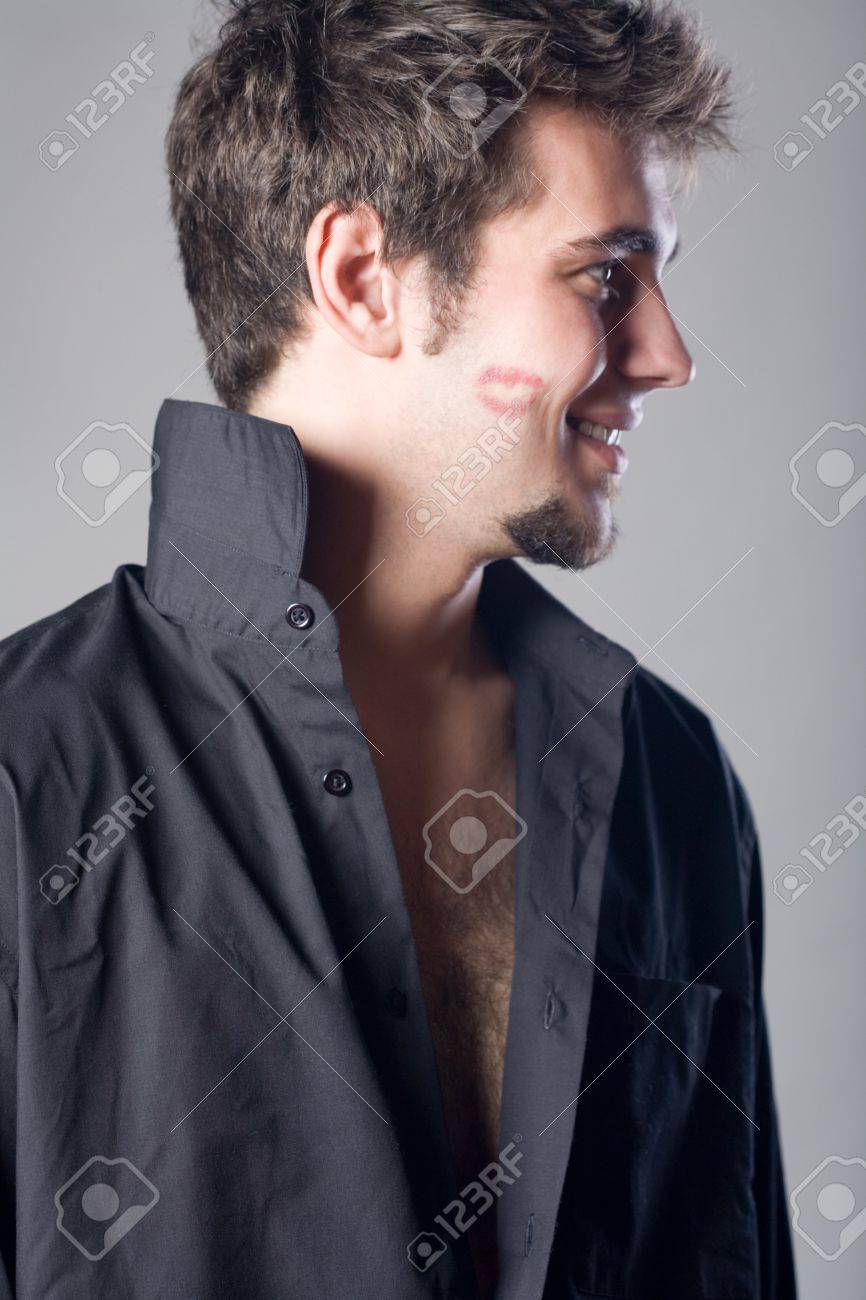 Young man with lipstick kiss, smiling Stock Photo - 802624