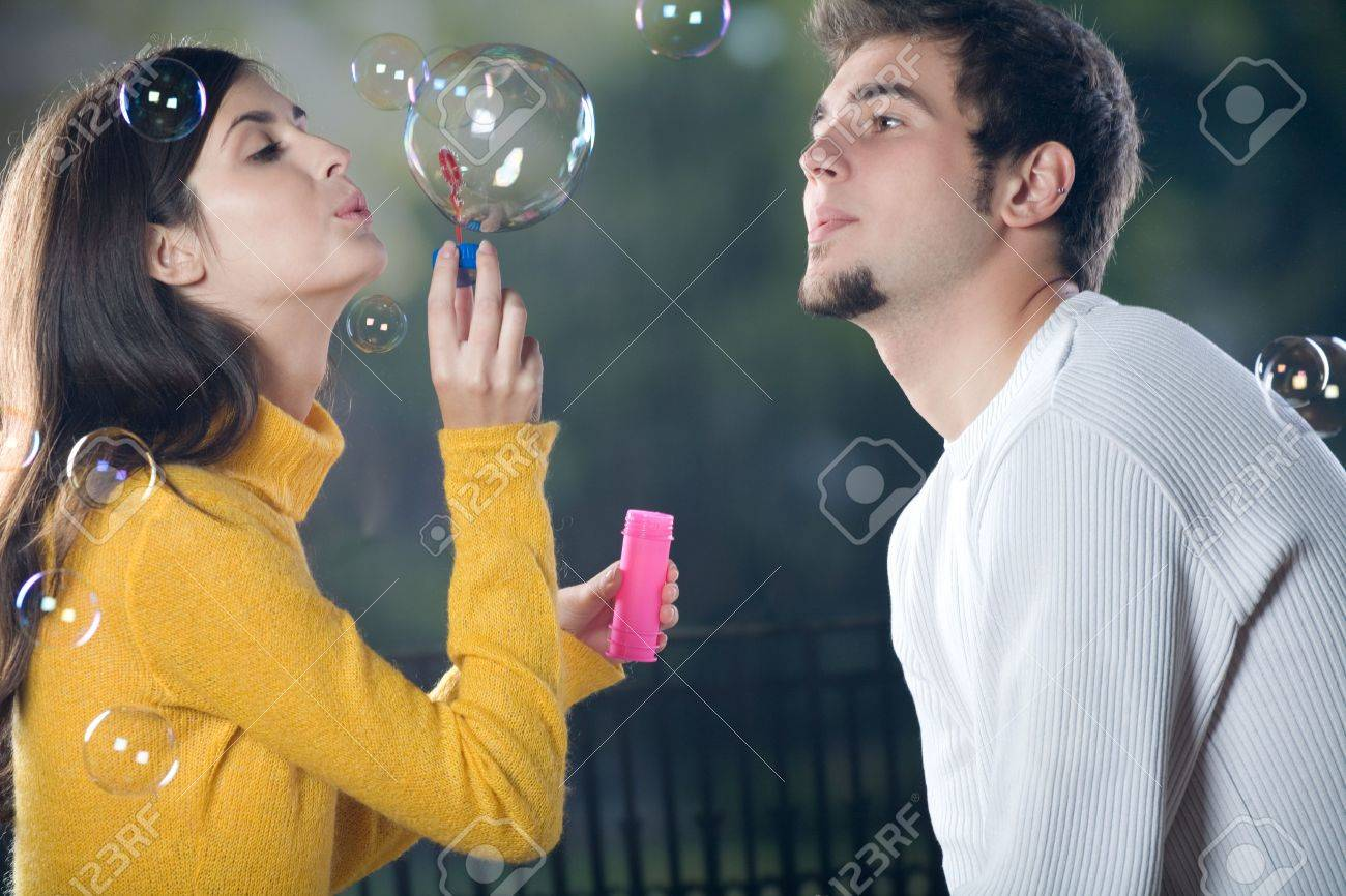 Young couple blowing bubbles, outdoors Stock Photo - 848747