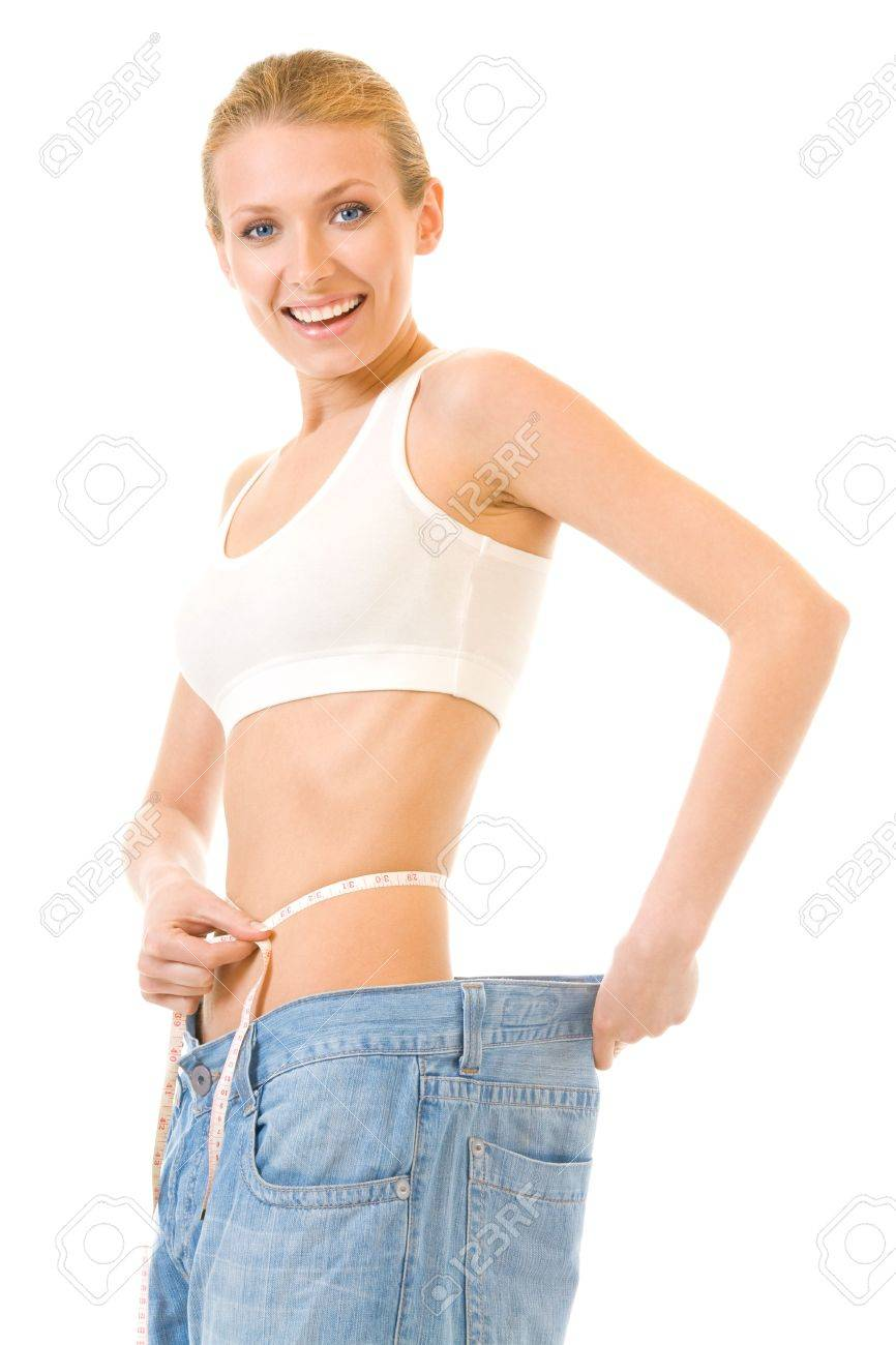 Woman measuring waist with a tape measure in old jeans, isolated Stock Photo - 3005012