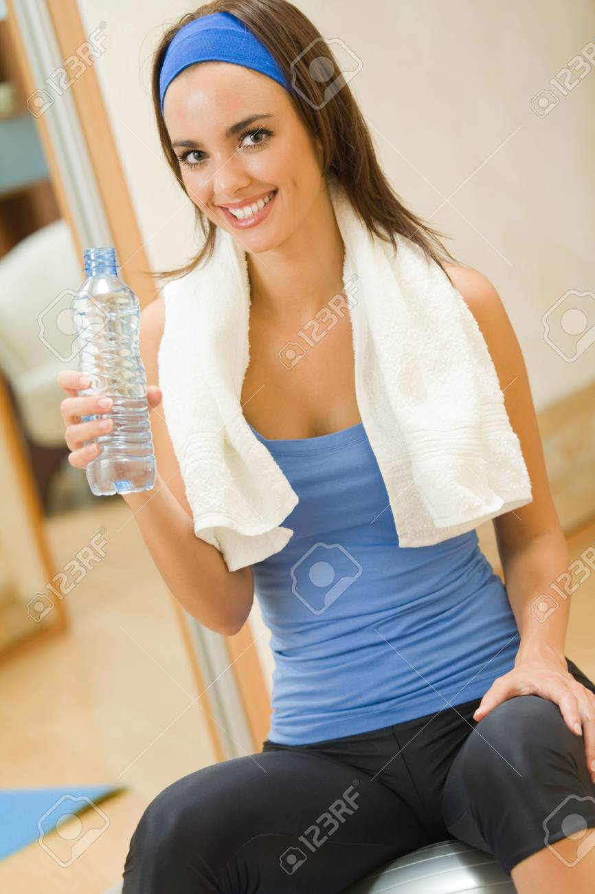 Young happy woman doing fitness exercises at home Stock Photo - 3505770