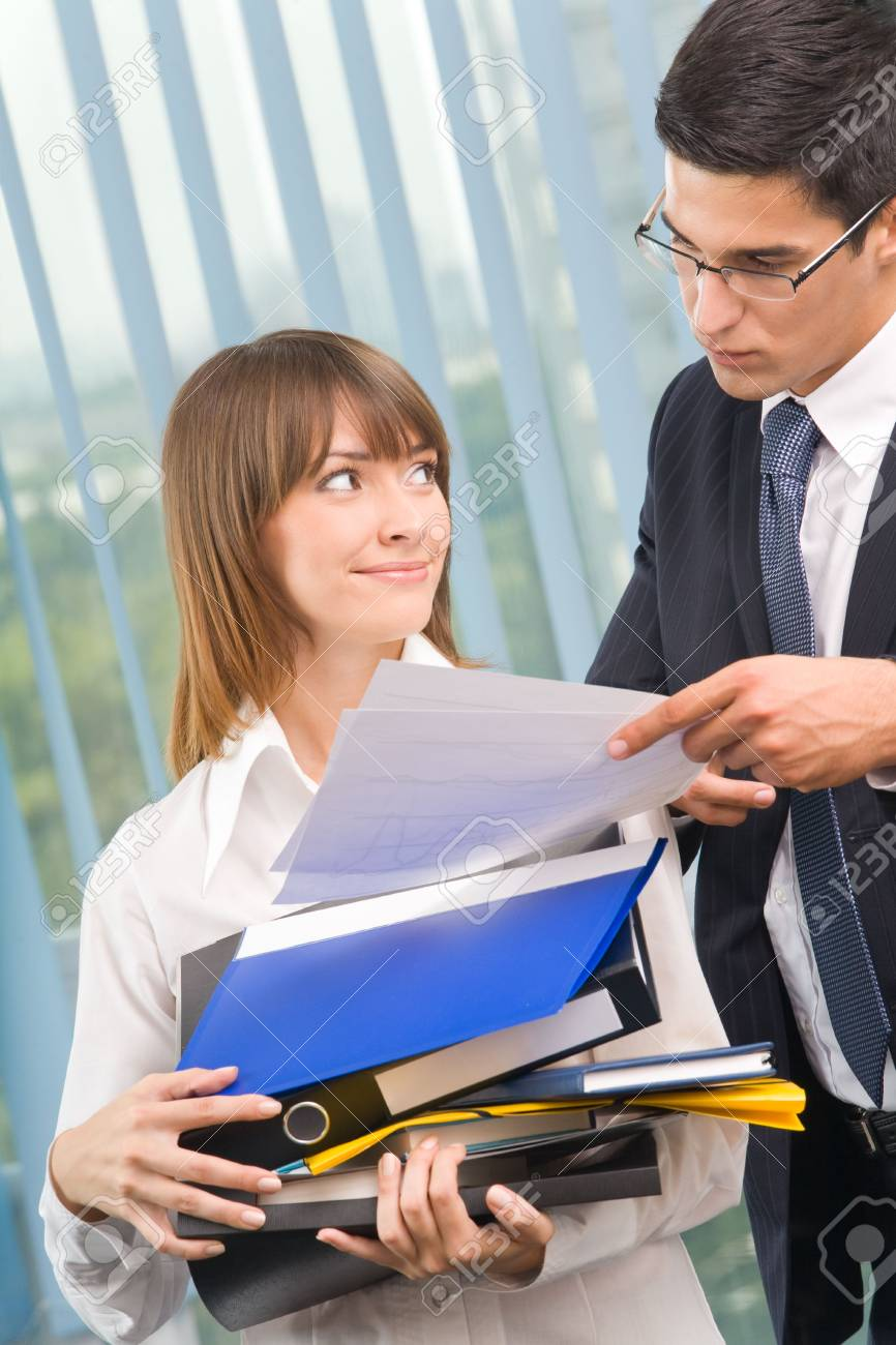 Two businesspeople working together at office Stock Photo - 3535553