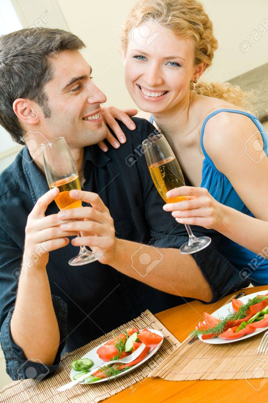 Young couple celebrating with champagne at home Stock Photo - 5675741