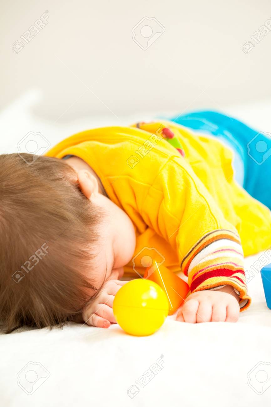 Sleeping baby girl on bed Stock Photo - 6600707