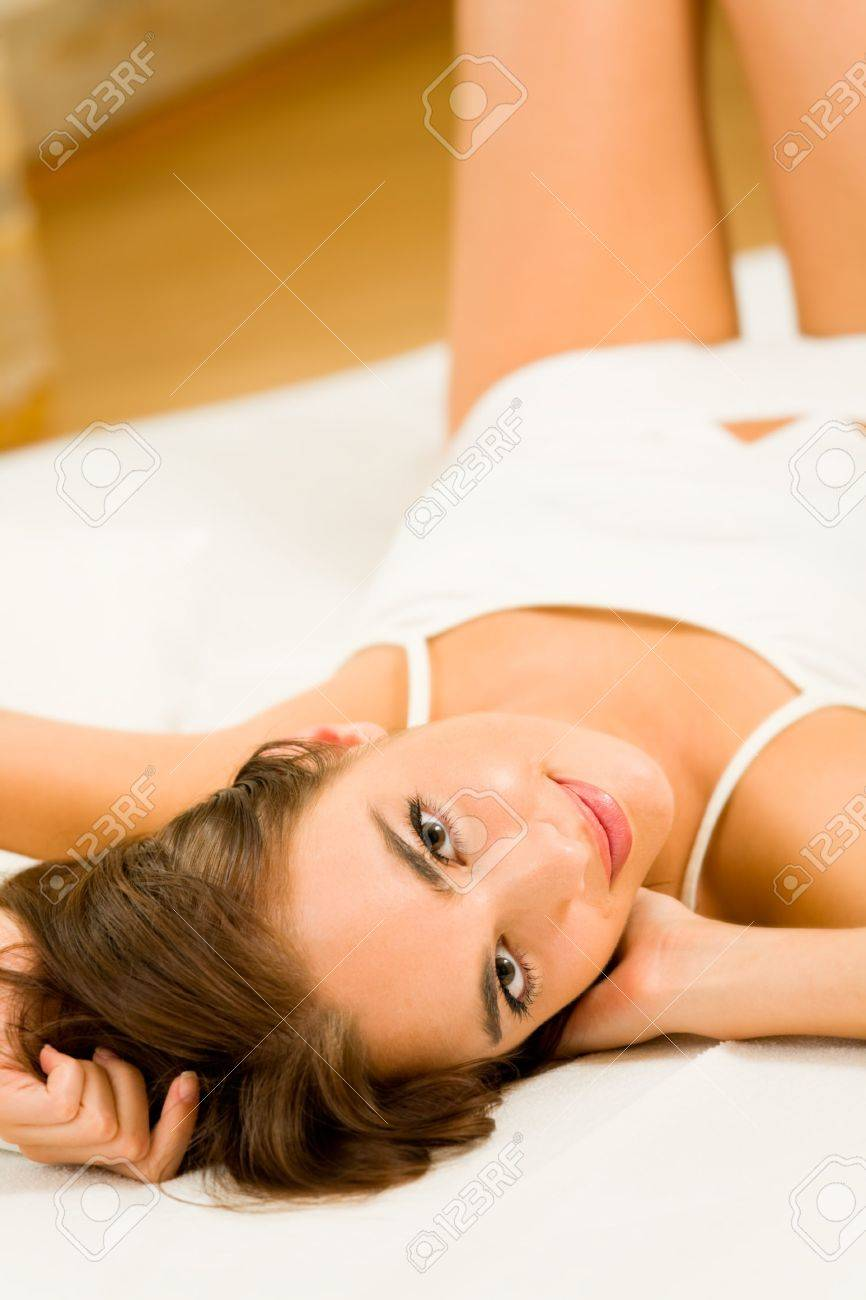 Young happy smiling woman waking up at bedroom Stock Photo - 6875716