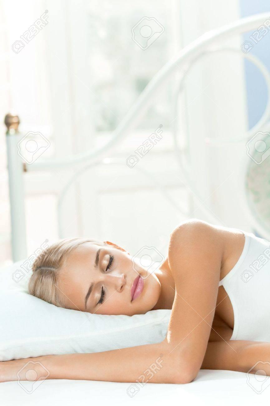 Young sleeping woman at bedroom Stock Photo - 7541817