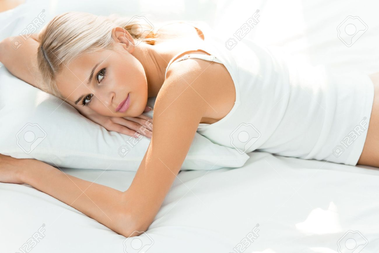 Young happy woman waking up at bedroom Stock Photo - 7541848