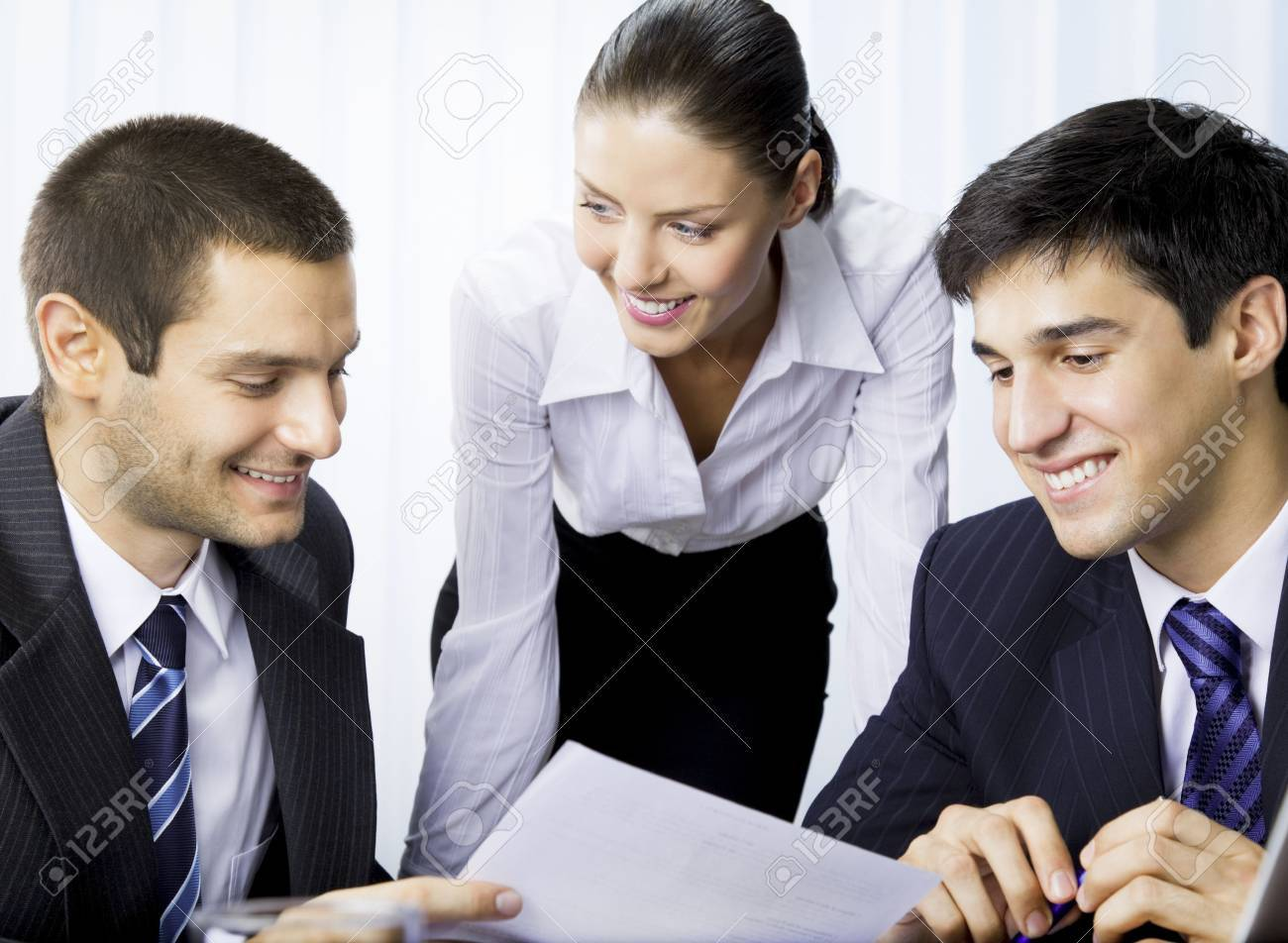 Three businesspeople working with document at office Stock Photo - 7717626
