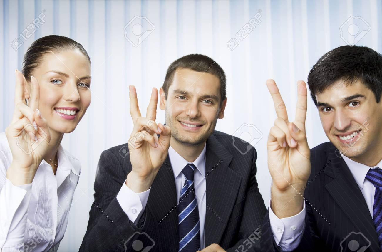 Happy successful gesturing businesspeople at office Stock Photo - 7778473