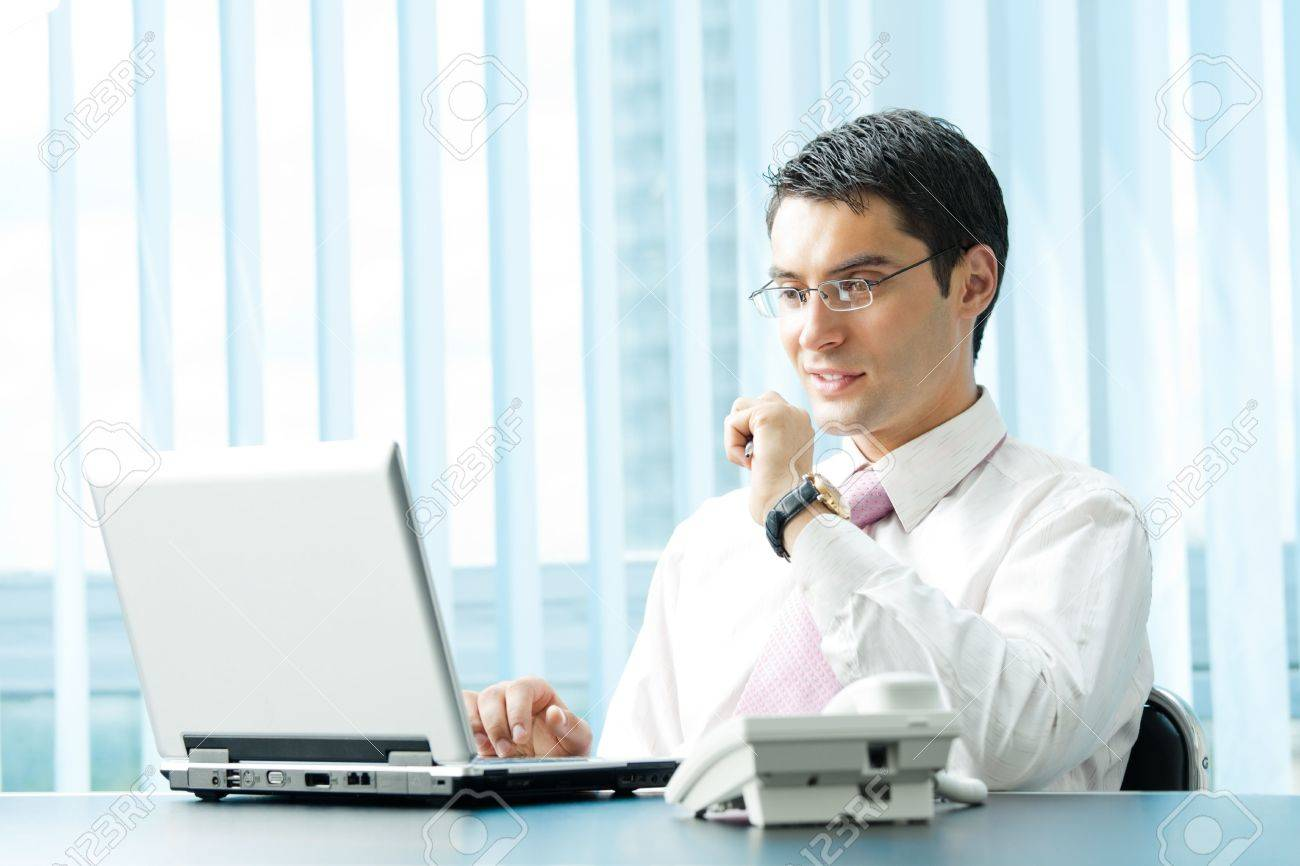 Businessman with laptop at office Stock Photo - 8001754