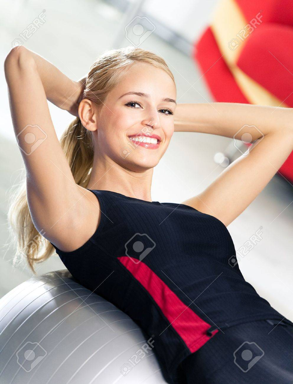 Portrait of young happy smiling woman in sportswear, doing fitness exercise with fit ball, indoors Stock Photo - 8266014