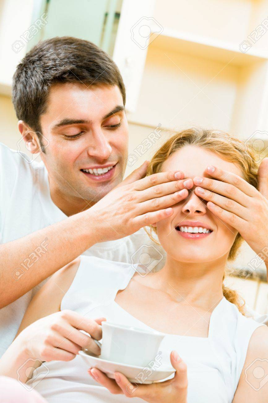 Young happy amorous couple having fun at home Stock Photo - 8697464