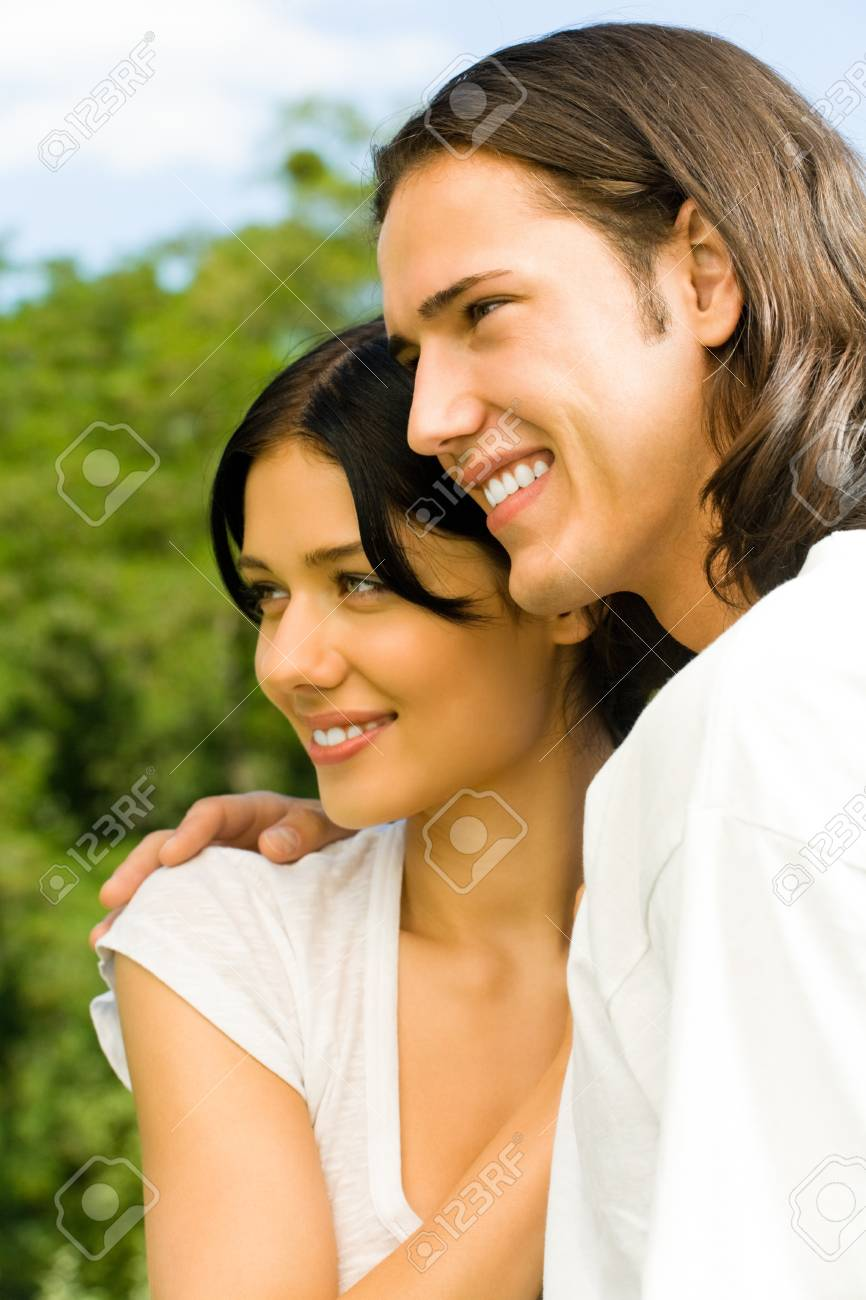 Happy smiling young couple on romantic date outdoors Stock Photo - 9508818