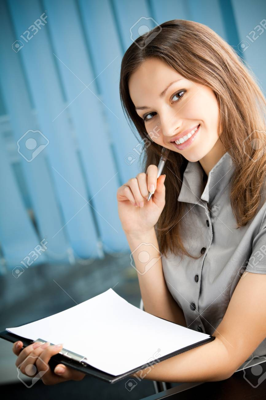 Portrait of writing happy smiling businesswoman working at office Stock Photo - 9751277