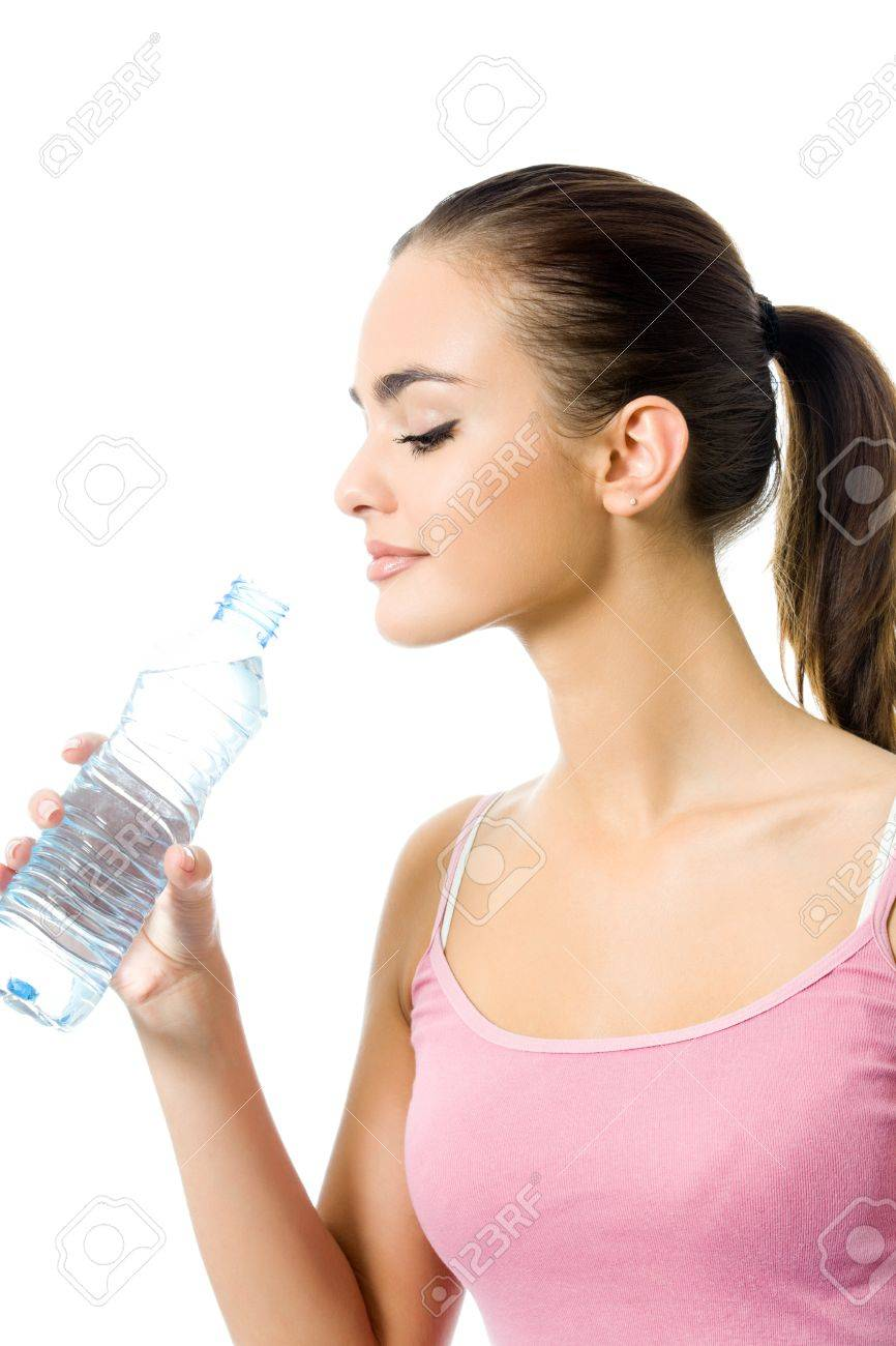 Young happy smiling woman in sportswear with water, isolated on white background Stock Photo - 9751266