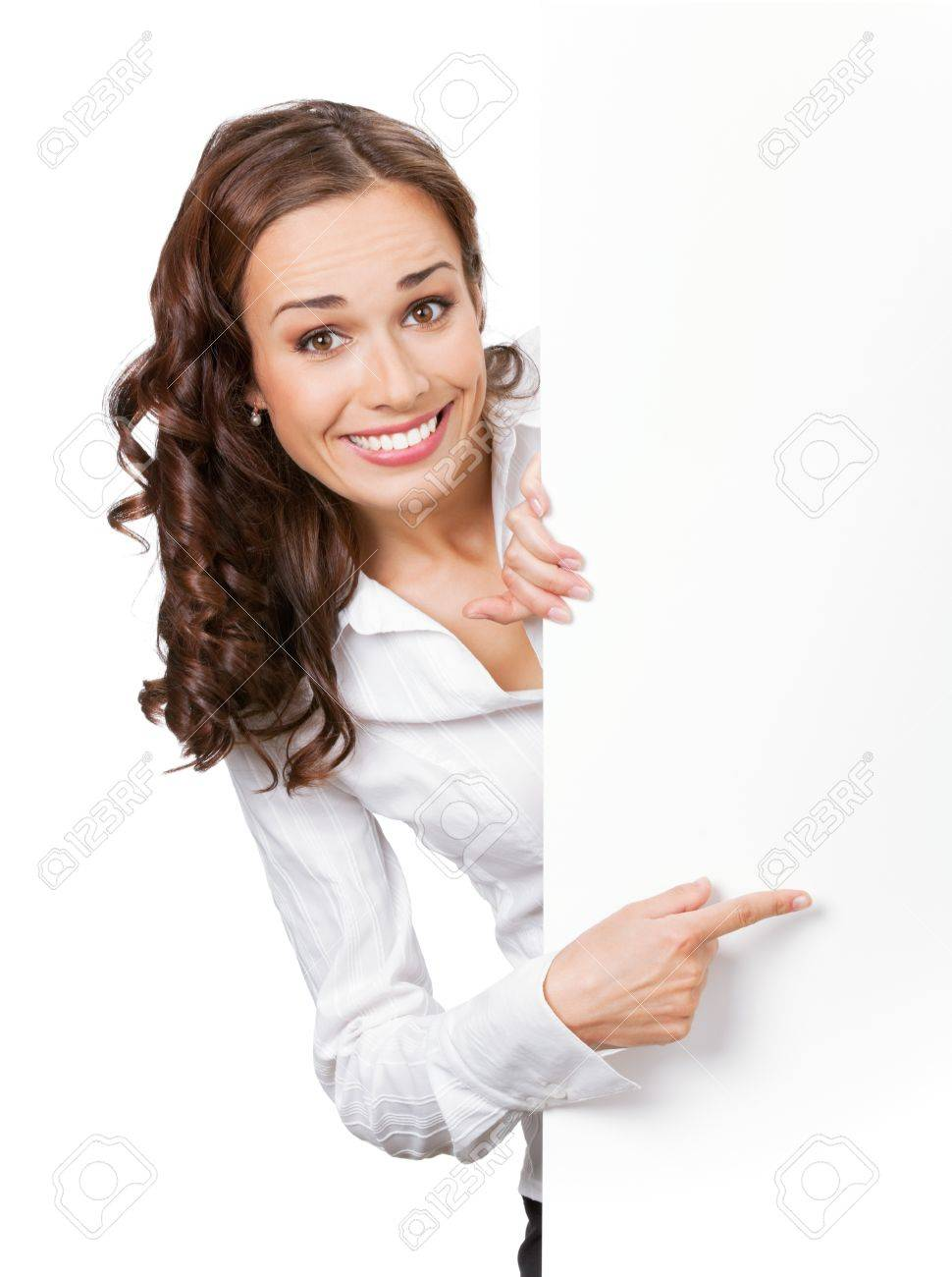 Happy smiling young business woman showing blank signboard, isolated on white background Stock Photo - 9896281