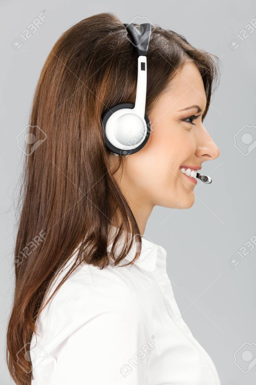 Portrait of happy smiling cheerful customer support phone operator in headset, over grey background Stock Photo - 10468149