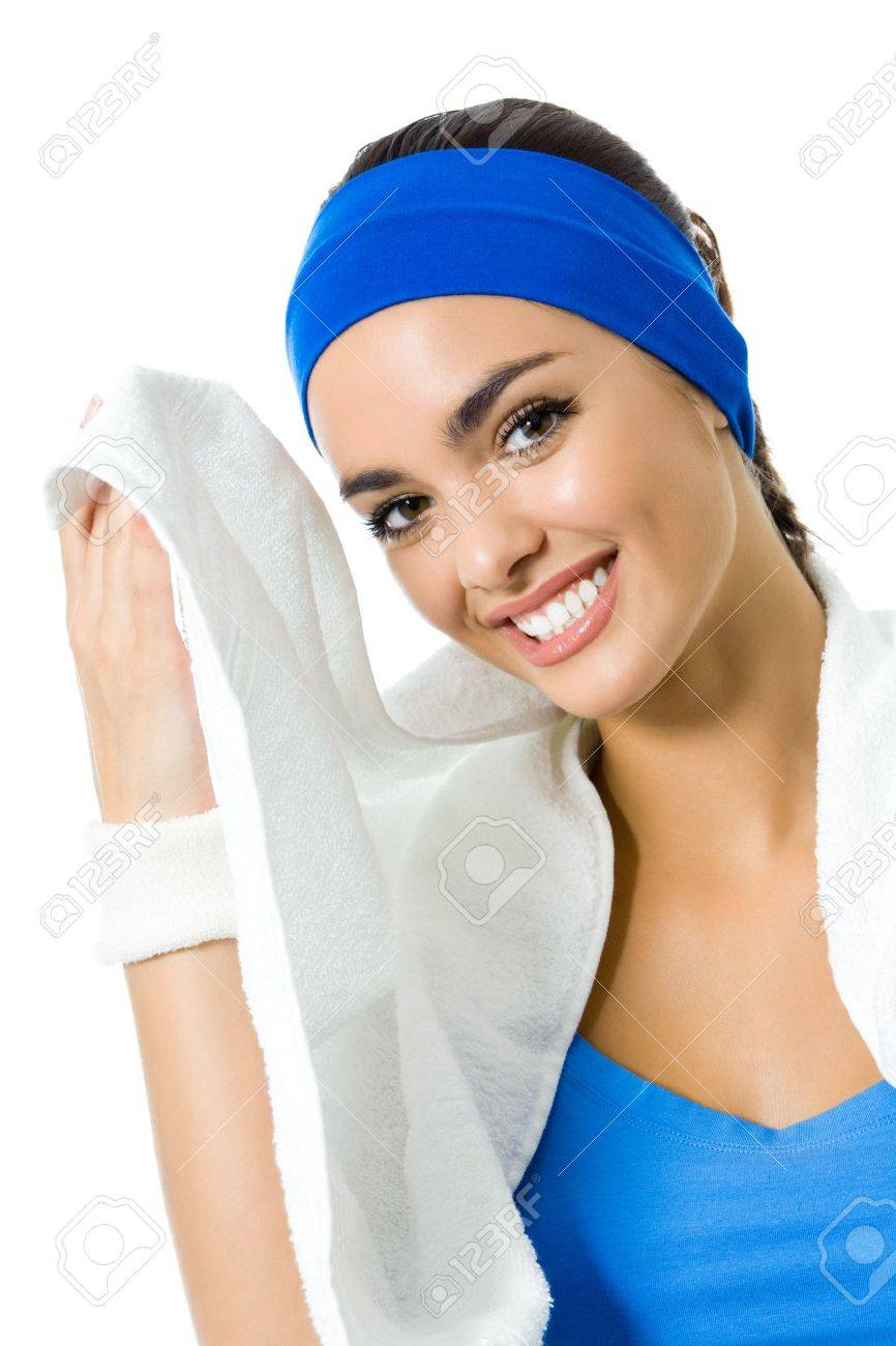 Portrait of happy smiling young woman in fitness wear with towel, isolated on white background Stock Photo - 10611699