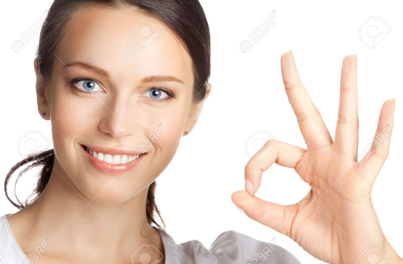 Happy smiling beautiful young business woman showing okay gesture, isolated over white background Stock Photo - 10914840