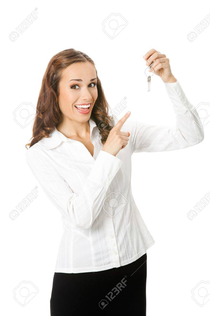 Young happy smiling business woman or real estate agent showing keys from new house, isolated on white background Stock Photo - 12234634