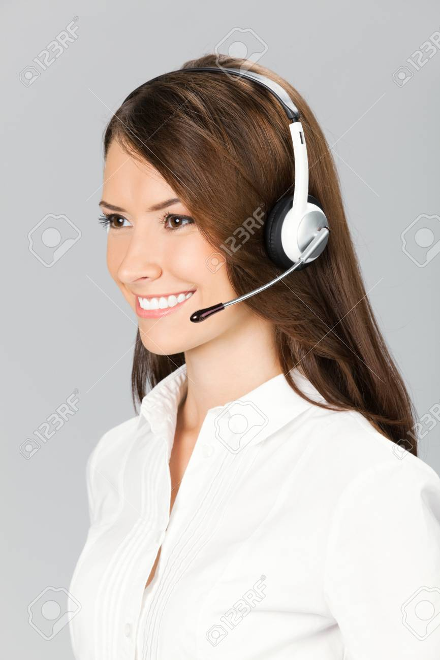 Portrait of happy smiling cheerful customer support phone operator in headset, over gray background Stock Photo - 12926645