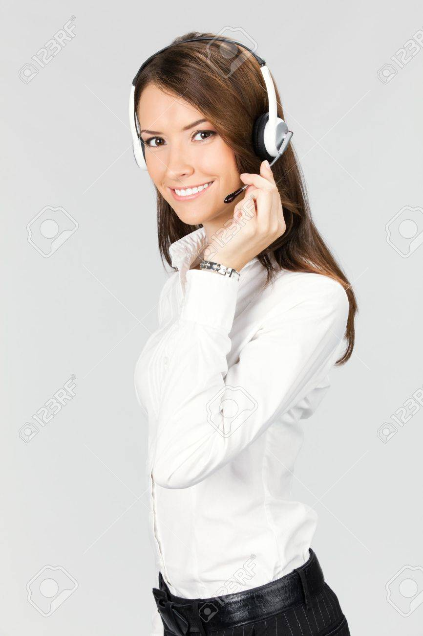 Portrait of happy smiling cheerful customer support phone operator in headset, over gray background Stock Photo - 12910791
