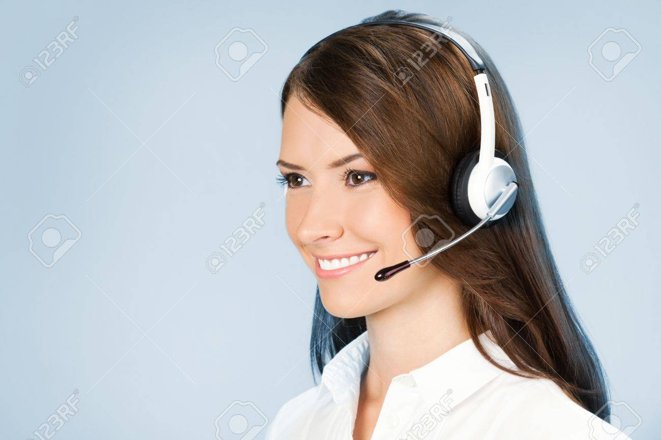 Portrait of happy smiling cheerful customer support phone operator in headset, over blue background Stock Photo - 15025631