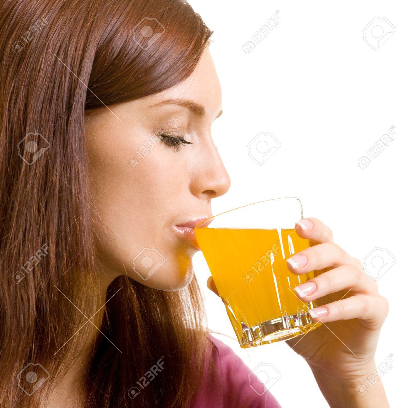 Beautiful woman drinking juice, isolated over white background Stock Photo - 15025653