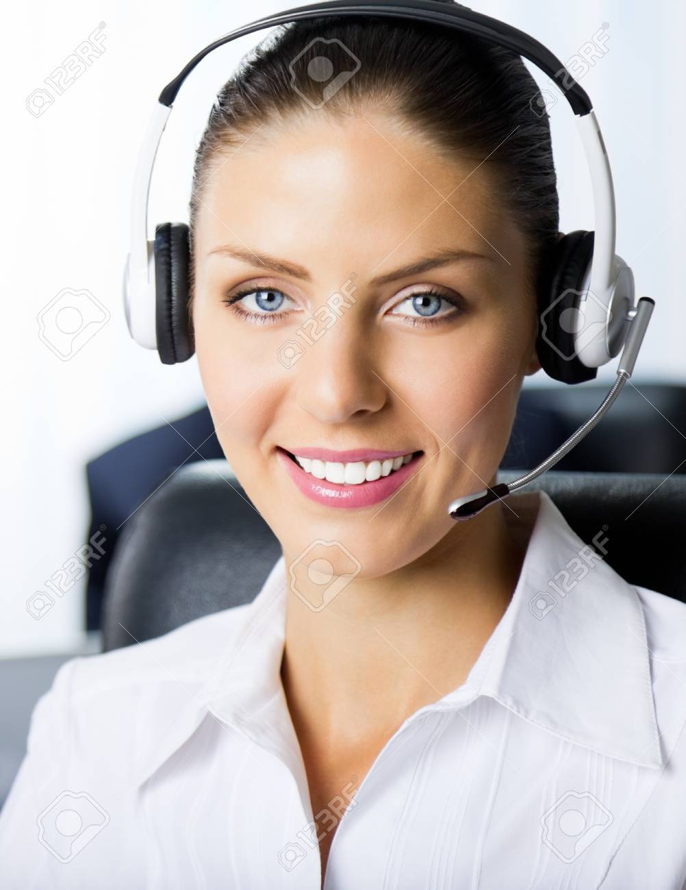 Portrait of female support phone operator at workplace Stock Photo - 15540624