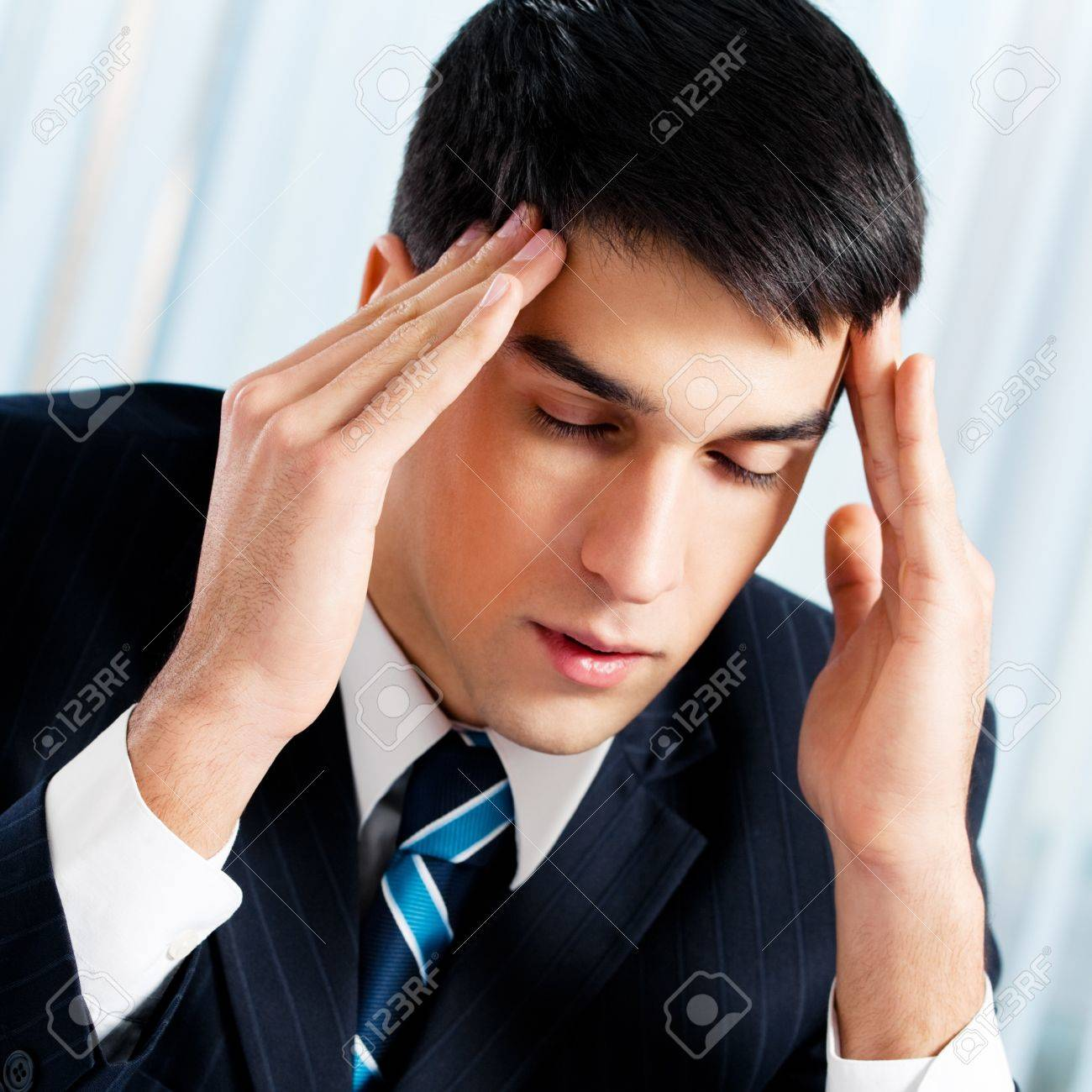 Thinking, tired or ill with headache businessman at office Stock Photo - 18658684