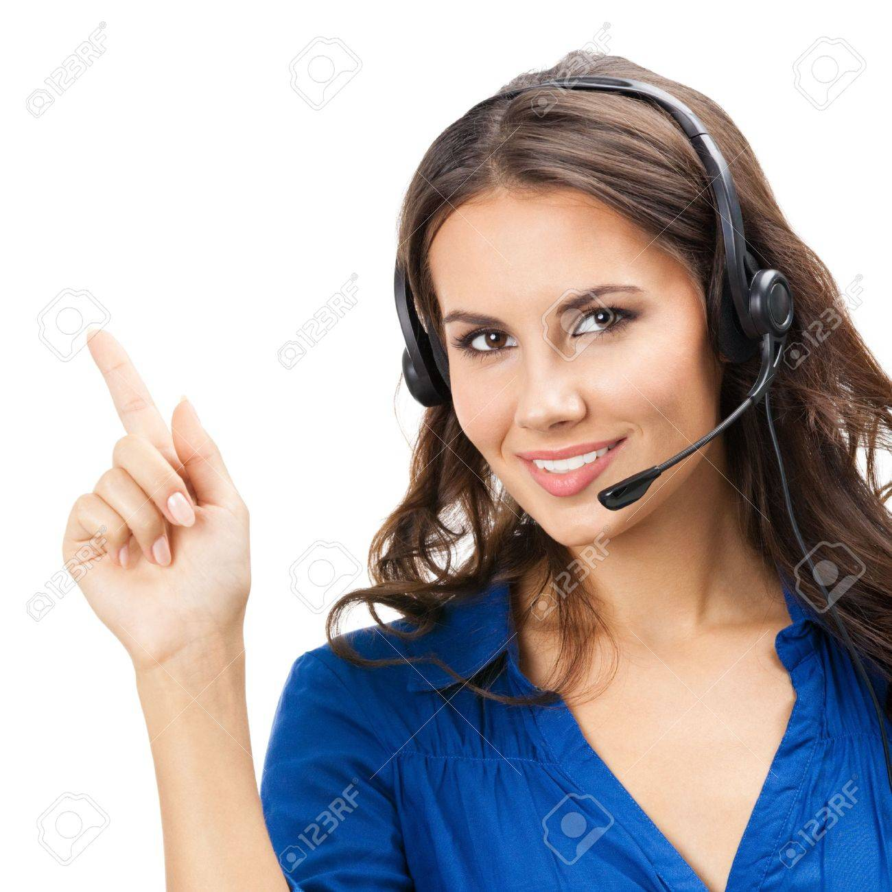 Portrait of happy smiling cheerful beautiful young support phone operator showing, isolated over white background Stock Photo - 20406258