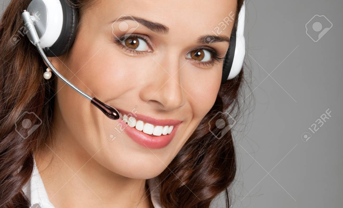 Portrait of happy smiling cheerful customer support phone operator in headset, over gray background Stock Photo - 20996236